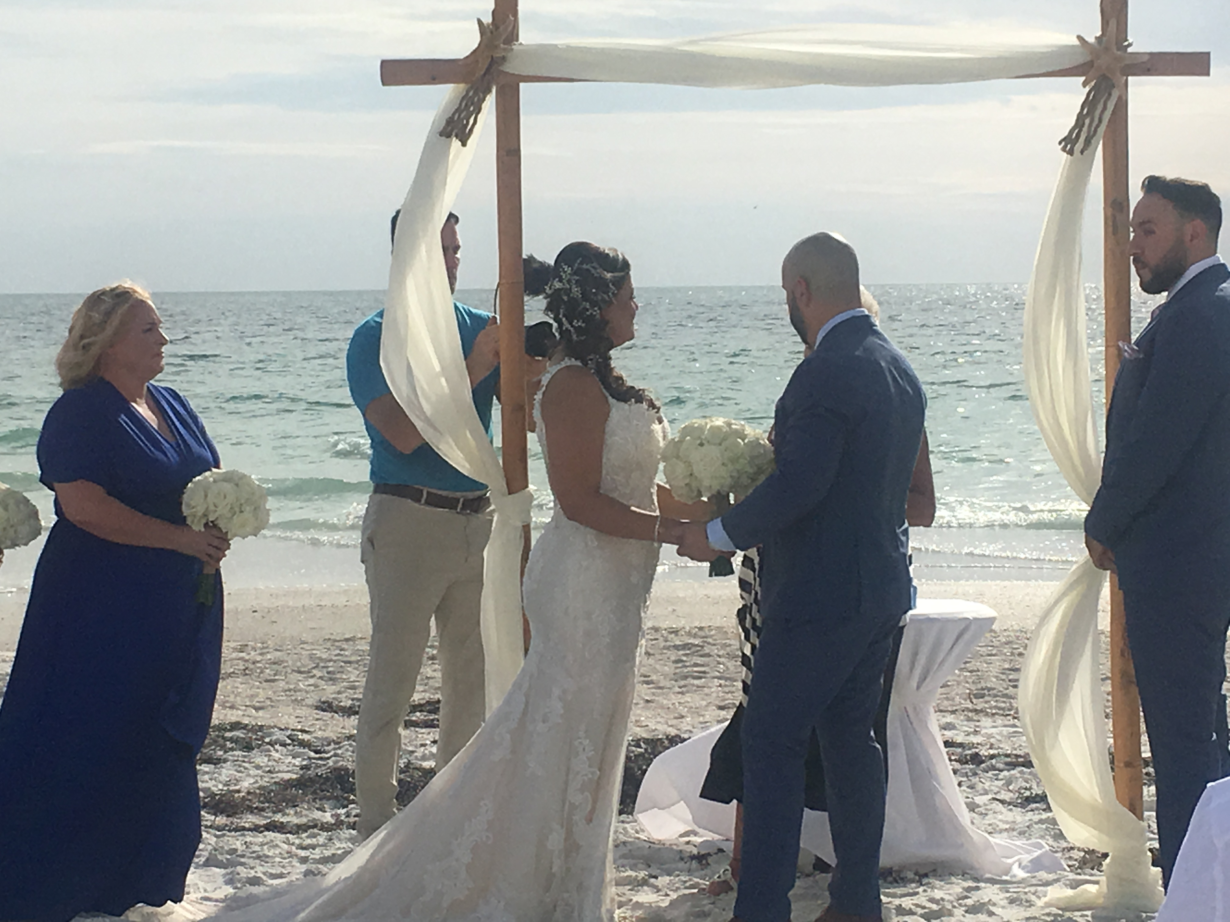 Destination bilingual beach wedding ceremony